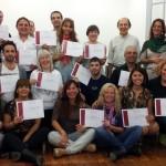 Alumnos recibiendo el titulo de la carrera de coaching organizacional